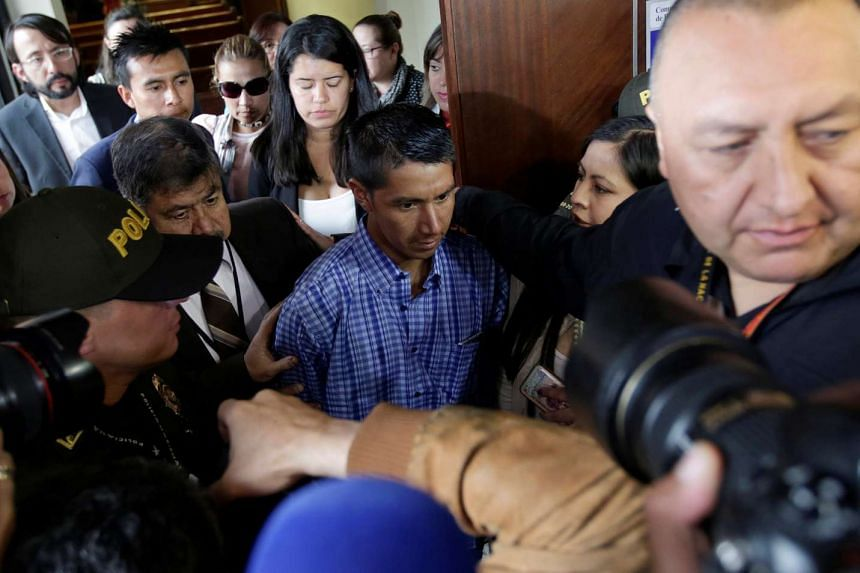 Juvencio Samboni (centre), leaves court after hearing the conviction of Rafael Uribe Noguera for the murder of his daughter Yuliana.