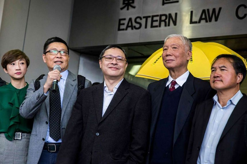(From left) Lawmaker Tanya Chan, academic Chan Kin Man, academic Benny Tai, reverend Chu Yui Ming and former lawmaker Lee Wing Tat outside the Eastern District Court in Hong Kong on March 30, 2017.