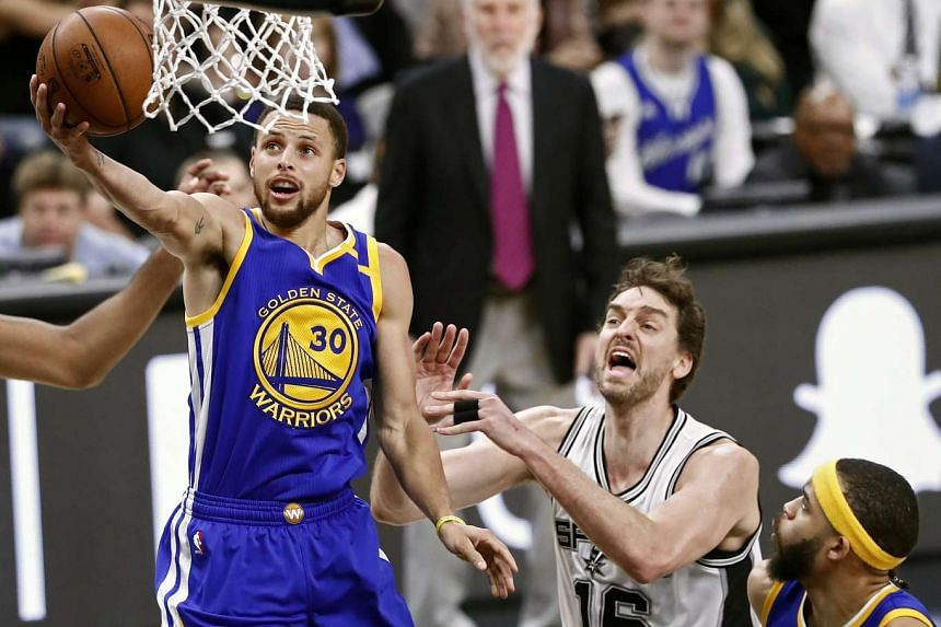 Golden State Warriors guard Stephen Curry going to the basket against San Antonio Spurs center Pau Gasol in the second half of the NBA basketball game at the AT&T Center in San Antonio, Texas, US, on March 29, 2017.