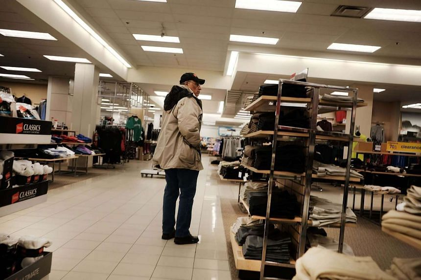 A customer browses at a clothing store in a mall in Waterbury, Connecticut.