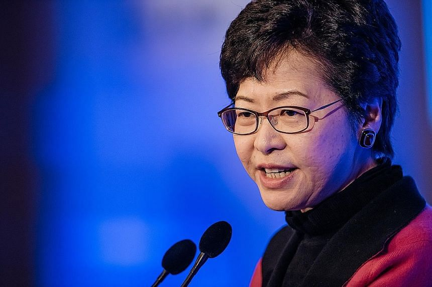 Hong Kong Chief Executive-elect Carrie Lam (above) has pledged to improve liveability and freedom in the city and increase transport connectivity to China to convince companies to move out of Singapore.