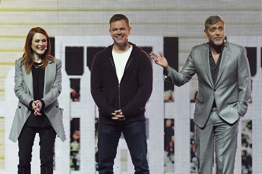 (From left) Julianne Moore, Matt Damon and George Clooney presented footage from noir thriller Suburbicon. Actor Zac Efron lent his star power to the segment on the upcoming adaptation of the popular 1990s television show, Baywatch.