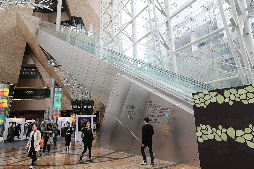 The 45m-long escalator at Langham Place suddenly reversed direction, sending dozens of people tumbling down.