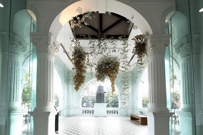 Filipino artist Ryan Villamael's paper-and-felt installation, Locus Amoenus, was suspended from the ceiling of the second floor during the Singapore Biennale. The centrepiece of the entrance foyer at the Singapore Art Museum is a bronze statue of St
