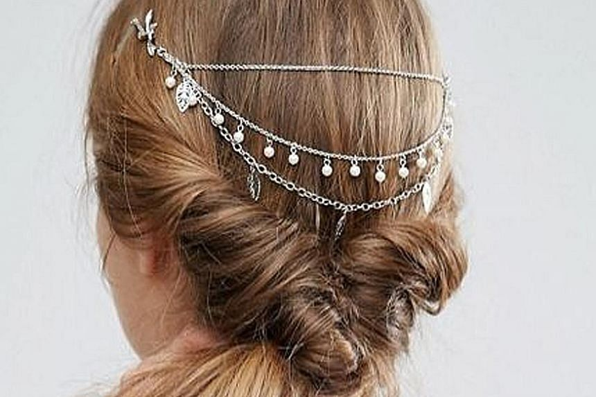 A screenshot of the social media post by celebrity hairstylist Adir Abergel of the hair chain comb worn by actress Vanessa Kirby.