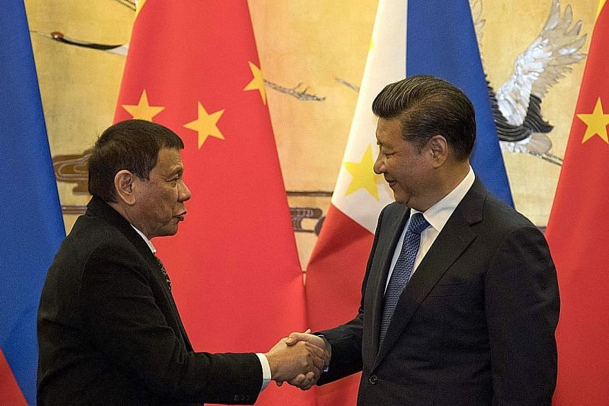 Mr Duterte meeting Mr Xi in Beijing last October. The Philippine leader has repeatedly said he does not want to go to war with Beijing over the South China Sea row, and has pivoted Manila's foreign policy away from the US towards China.