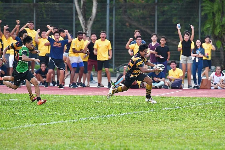 Finan Siow of Anglo-Chinese School (Independent) scoring his side's second try in the 25-12 victory in the Schools National B Division rugby final against Raffles Institution yesterday. ACS(I) have now won the title three times in a row.