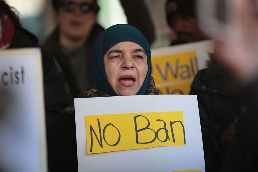 Demonstrators protesting outside the office of Immigration and Customs Enforcement (ICE) on March 16, 2017, in Chicago, Illinois.