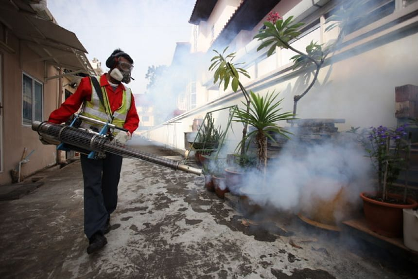 Pest control workers carrying out fogging at Simon Place on Thursday (March 30), after Singapore's first Zika cluster in 2017 was detected there.