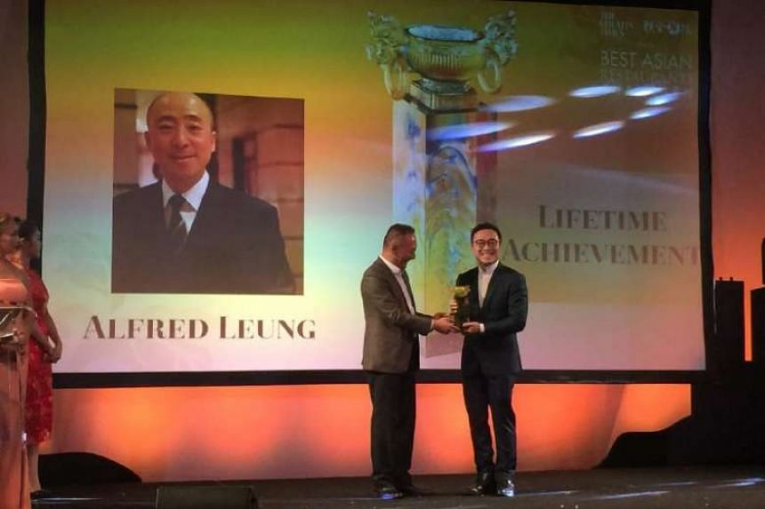 Mr Alfred Leung's son Kenny, who oversees group operations for the Imperial Treasure Restaurant Group, accepting the Lifetime Achievement award on his father's behalf at the Best Asian Restaurants Awards on March 29, 2017.