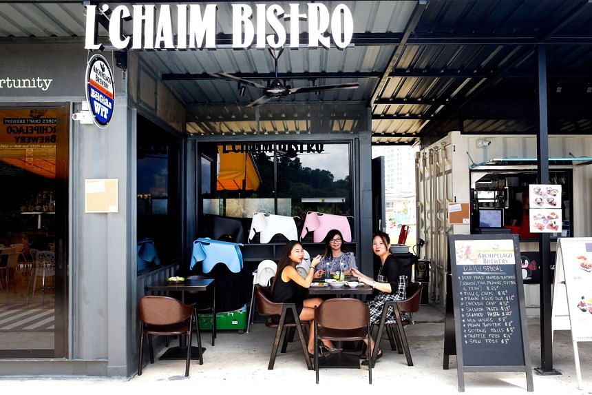 """L'Chaim Bistro is one of seven container restaurants opened at Seed@Social Innovation Park. The restaurant's owner Amy Lee (centre) says the """"tranquil location"""" and """"unique container concept"""" of Seed are crucial in attracting the roughly 1,"""