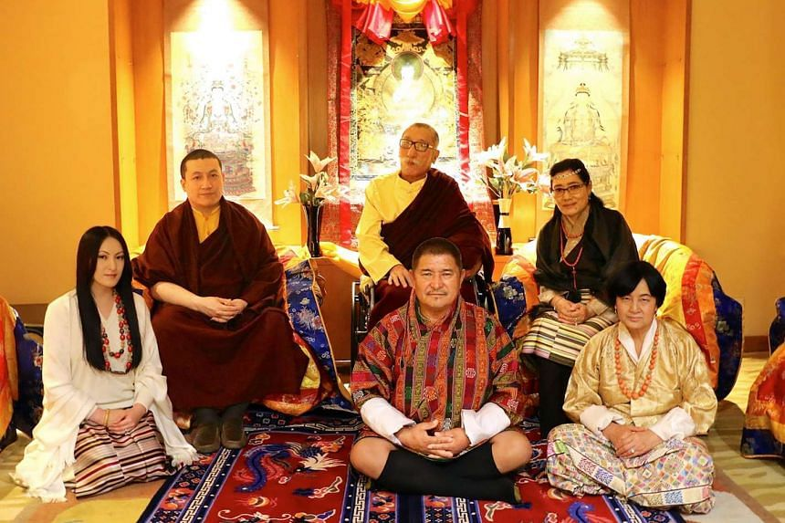 Thaye Dorje (second from left) and his parents Mipham Rinpoche and Dechen Wangmo Bottom (both seated at the back) and his wife Rinchen Yangzom (left) and her parents Chencho and Kunzang (both seated in front) in New Delhi on March 25, 2017.
