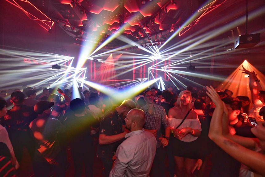 Partygoers enjoy the atmosphere at Zouk's new premises in Clarke Quay, on Dec 17, 2016.