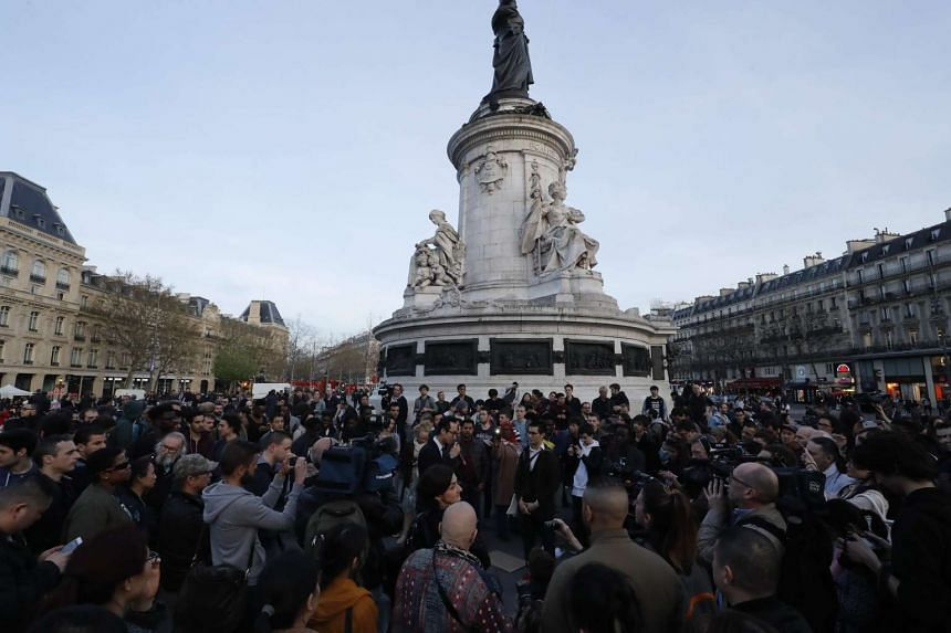 People gather during a demonstration for justice on the Place de la Republique (Republic's Square) on March 30, 2017 following the death of Chinese Liu Shaoyo during a police intervention.