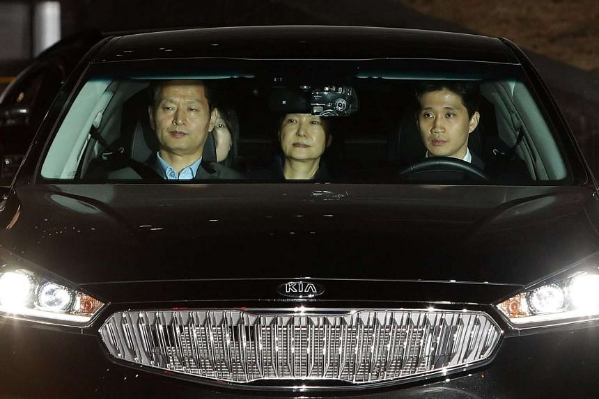 Former president of South Korea Park Geun Hye (centre) leaving the Seoul Central Prosecutors' Office on Friday (March 31).