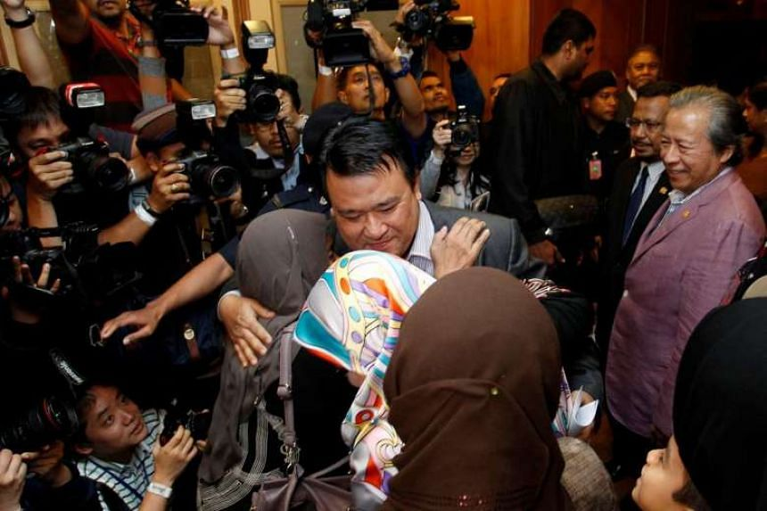 Mohd Nor Azrin Md Zain, counsellor at Malaysia's embassy in Pyongyang, hugs members of his family as he returns home from Pyongyang, at the Kuala Lumpur International Airport.