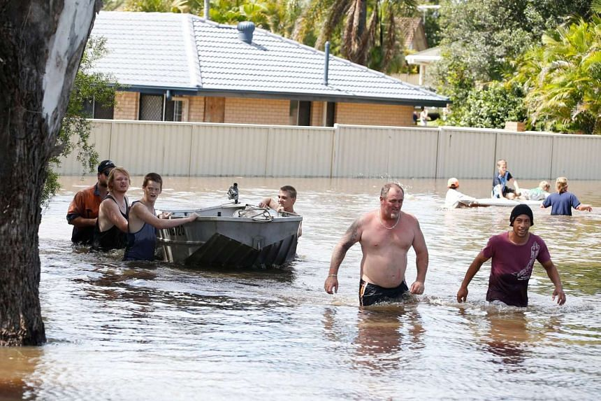 Residents engage in rescue efforts near the flooded Yorkshire Crescent in Mount Warren Park, Queensland, Australia on March 31, 2017.