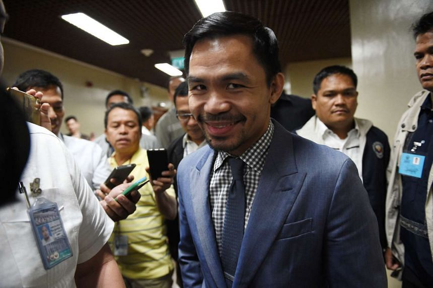 Manny Pacquiao arriving for a senate session in Manila on Feb 13, 2017.