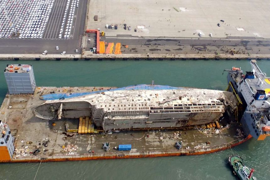 The Sewol ferry, lifted from where it sank some three years ago in the country's south-western waters, is brought to port in Mokpo, South Korea, on March 31, 2017.