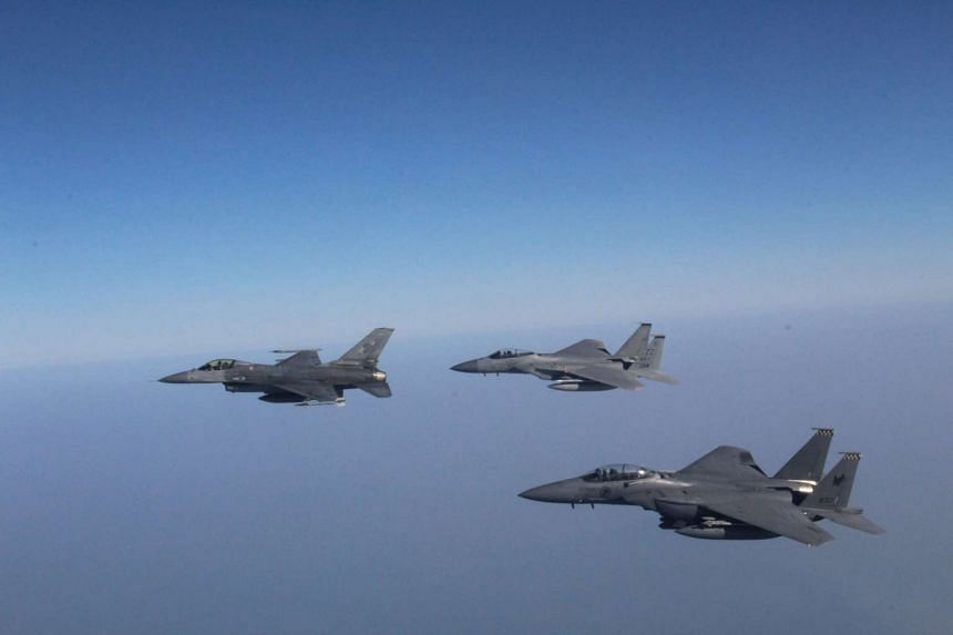 (From left) An F-16C from the Royal Thai Air Force, an F-15C from the United States Pacific Air Force and an F-15SG from the Republic of Singapore Air Force moving together during Exercise Cope Tiger.