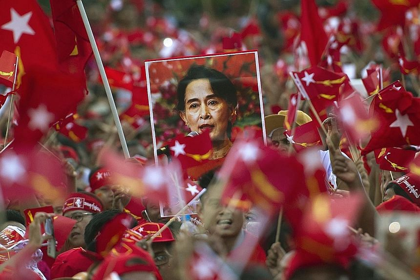 Ms Suu Kyi's supporters at one of her rallies in Yangon in November 2015. Tomorrow's by-election will be her party's first test at the polls since it won a landslide victory in Myanmar's general election that year.