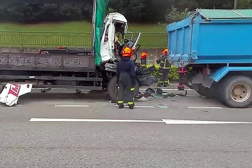 The Singapore Civil Defence Force had to use hydraulic rescue tools to extricate the driver from the lorry after its cab was smashed in.