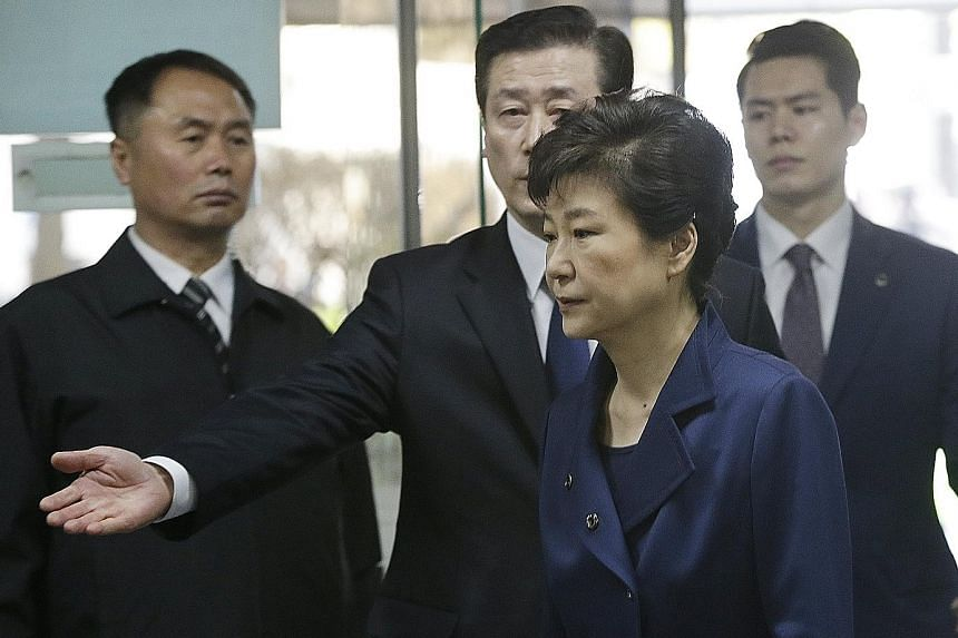 Ms Park arriving for the hearing yesterday. The prosecution says she may try to destroy evidence if she is not detained.
