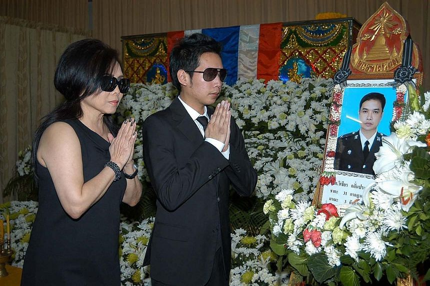 A file photo showing Mr Worayuth and his mother, Daranee, paying their last respects to Sergeant Wichian Klinprasert, who Mr Worayuth allegedly hit with his Ferrari in 2012.