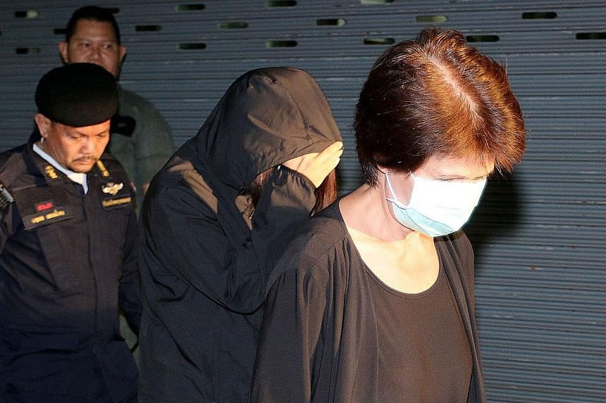 Juthamas (front) accepted the bribes while she was tourism chief in the early 2000s, according to the verdict. Judges also sentenced her daughter Jittisopha (behind her) to 44 years' jail for helping to hide the cash in overseas bank accounts.