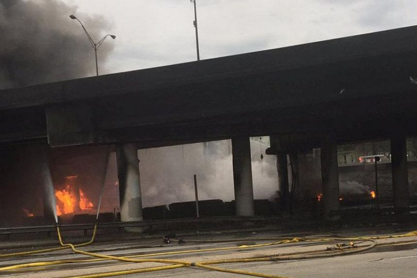 The fire being shown out of control underneath a highway overpass on interstate 85 before a section of the highway collapsed in Atlanta, Georgia, on March 30, 2017.