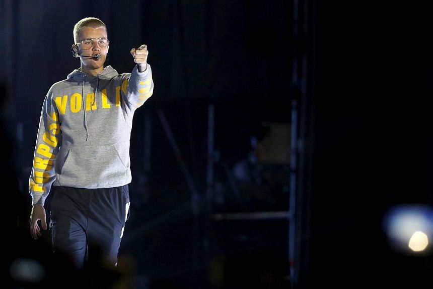Canadian singer Justin Bieber performs on stage during a concert at the National Stadium in Santiago, Chile.