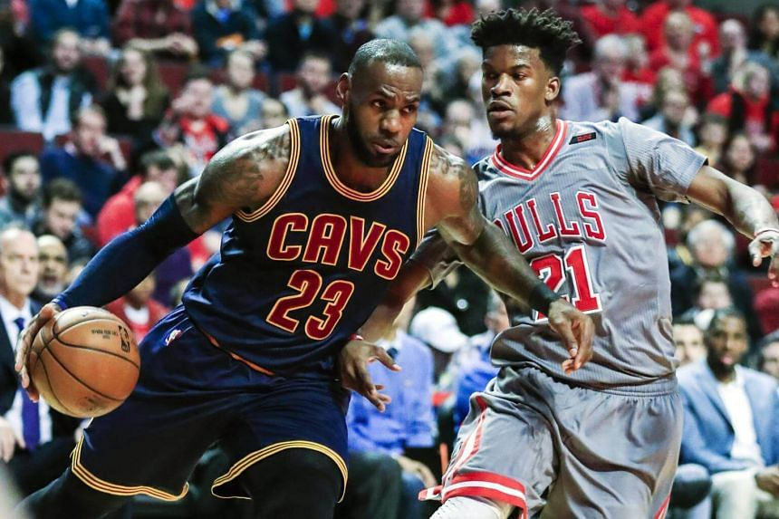 Cleveland Cavaliers forward LeBron James (left) drives to the basket on Chicago Bulls forward Jimmy Butler in the game in Chicago on March 30, 2017.
