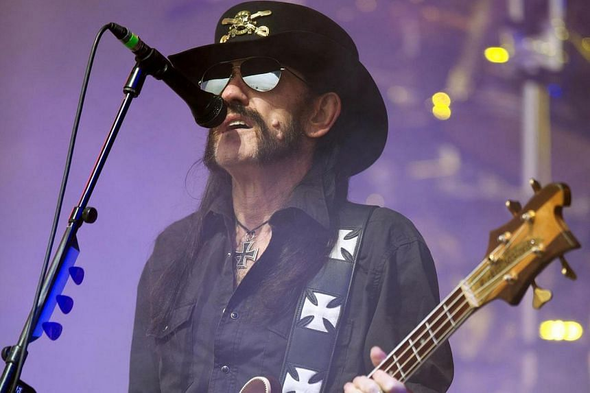 "British rock band Motorhead's lead singer Ian ""Lemmy"" Kilmister performing at the Glastonbury Festival of Music at Worthy Farm near the village of Pilton in Somerset, England."