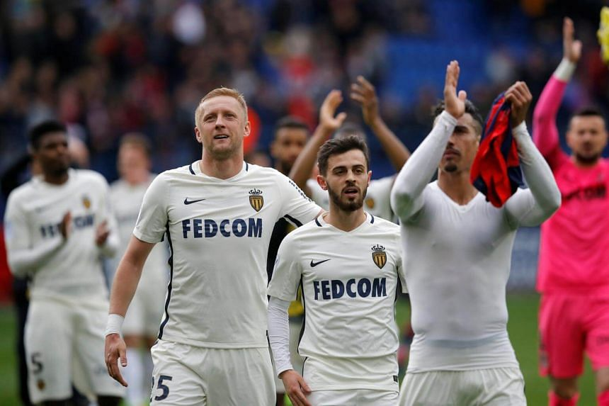 Monaco players Kamil Glik and Bernardo Silva at the end of a match against SM Caen on March 19.