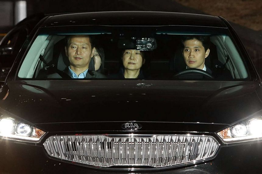 Ousted South Korean president Park Geun Hye (centre), leaves the prosecutors' office as she is transferred to a detention house in Seoul, on March 31, 2017.
