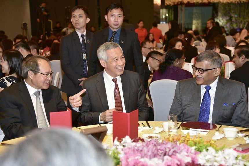 (From left)  Attorney-General Lucien Wong; Prime Minister Lee Hsien Loong and Chief Justice of Singapore Sundaresh Menon having a light moment after the launch of the AGC 150th Anniversary Commemorative Book.
