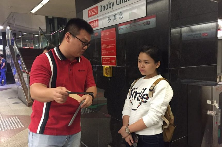 SMRT staff at Dhoby Ghaut station giving out complimentary tickets to commuters on March 30, 2017.
