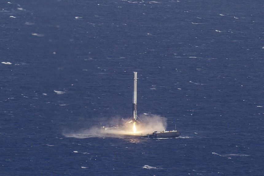 The reusable main-stage booster from the SpaceX Falcon 9 rocket making a successful landing on a platform in the Atlantic Ocean about 300 km off the coast of Florida.