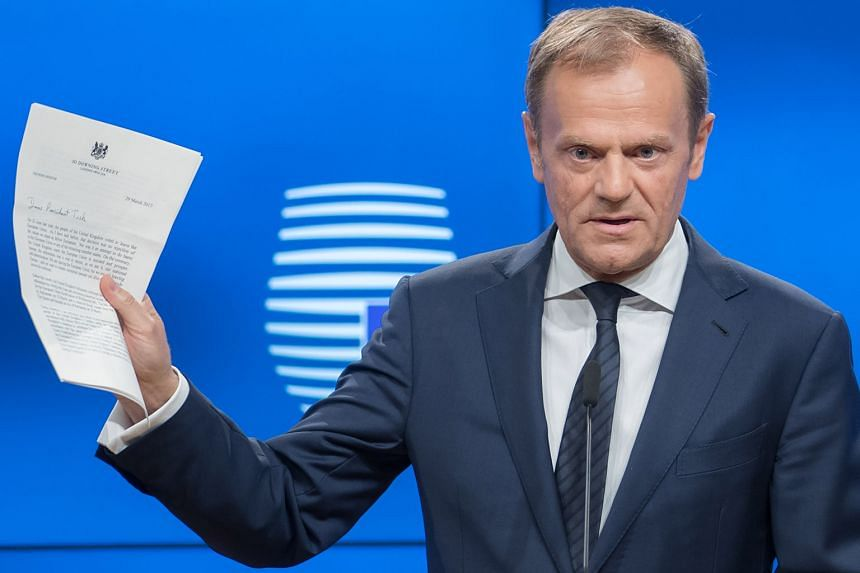 Mr Donald Tusk speaking at a news conference on Wednesday, while holding the letter invoking Article 50 of the Lisbon Treaty from Mrs Theresa May.