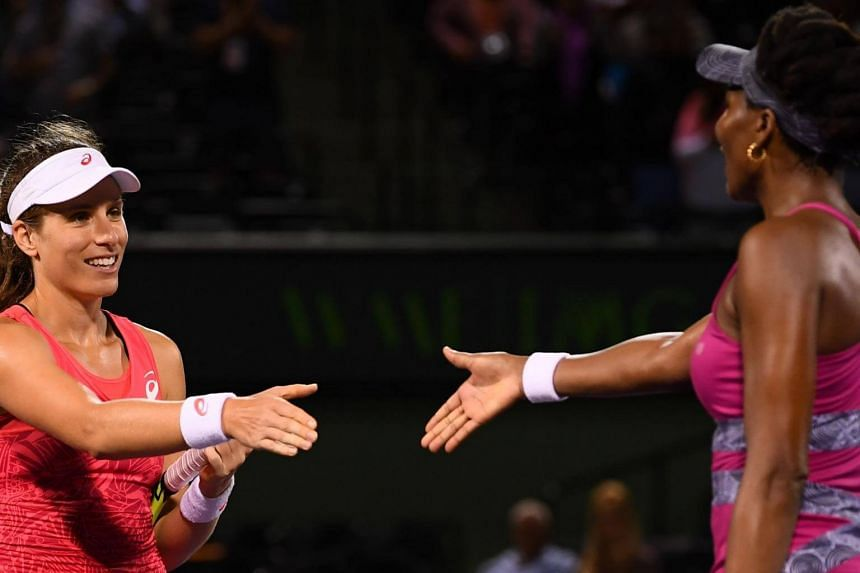Johanna Konta (left) of Great Britain shakes hands with Venus Williams after winning the semi-finals of the Miami Open at the Crandon Park Tennis Center on March 30, 2017.