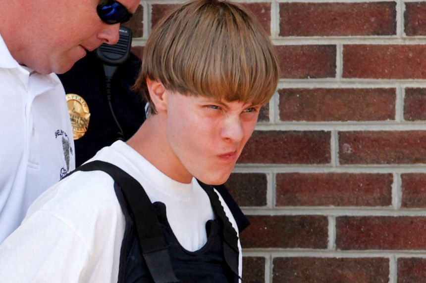 Police leading suspected shooter Dylann Roof into the courthouse in Shelby.