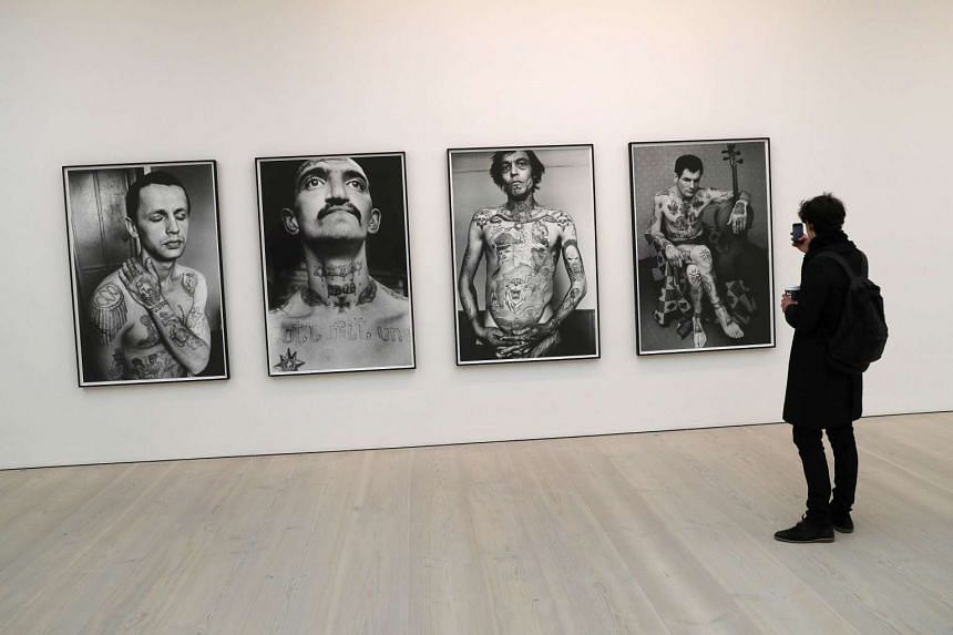 Russian Criminal Tattoo Encyclopaedia Series by Sergei Vasiliev during a press day to promote the exhibition From Selfie To Self-Expression at the Saatchi Gallery in London, Britain, on March 30, 2017.