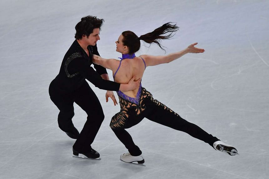 Canada's Tessa Virtue and Scott Moir compete in the ice dance/short dance event at the ISU World Figure Skating Championships in Helsinki, Finland on March 31, 2017.