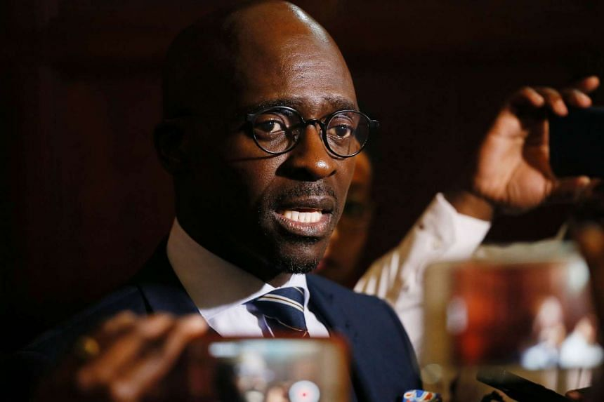 South Africa's newly appointed Finance Minister Malusi Gigaba speaks to the media following the official swearing-in ceremony of the new cabinet ministers at the Presidential Guest House in Pretoria, on March 31, 2017.
