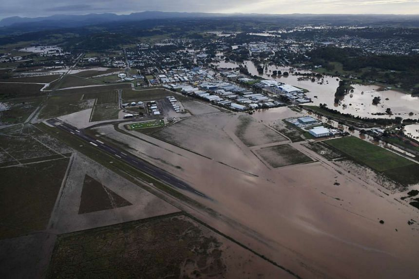 Water starts to recede from the runway of the Lismore Airport in Lismore, New South Wales, on Saturday (April 1). The Wilsons River breached its banks early morning flooding the far-northern NSW town of Lismore.