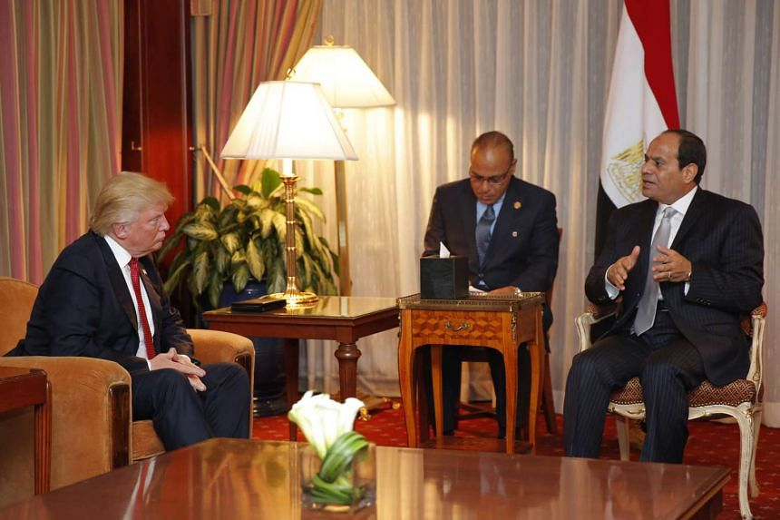 This file photo taken on Sept 20, 2016 shows then-Republican presidential candidate Donald Trump (left) looking on as Egyptian President Abdel Fattah el-Sisi speaks during a meeting at the Plaza Hotel in New York.