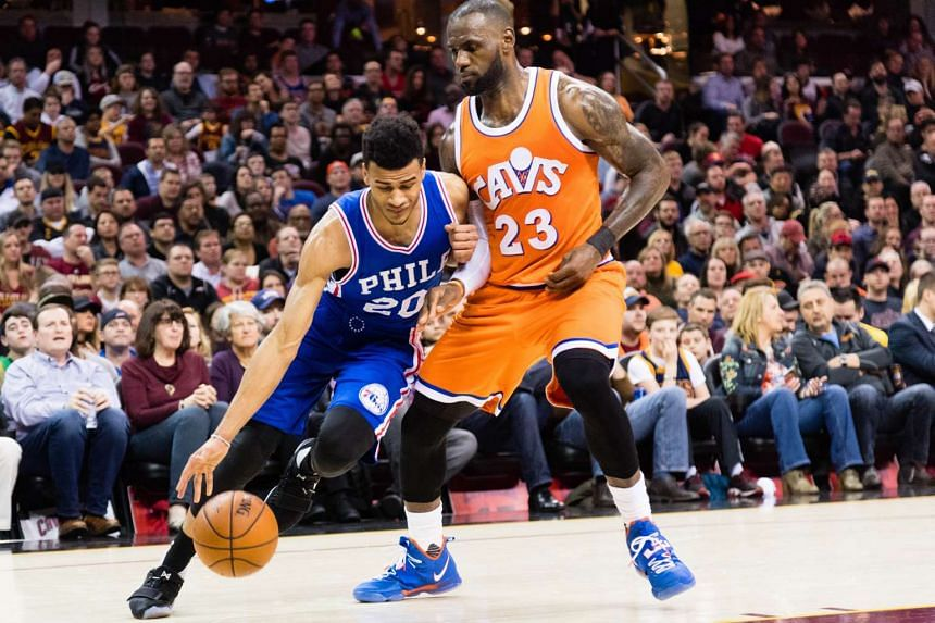 Timothe Luwawu-Cabarrot (left) of the Philadelphia 76ers drives around LeBron James (right) of the Cleveland Cavaliers during the first half at Quicken Loans Arena on March 31, 2017 in Cleveland, Ohio.
