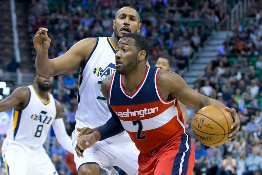 Washington Wizards guard John Wall (2) dribbles the ball around Utah Jazz center Boris Diaw (33) during the first half at Vivint Smart Home Arena on March 31, 2017.