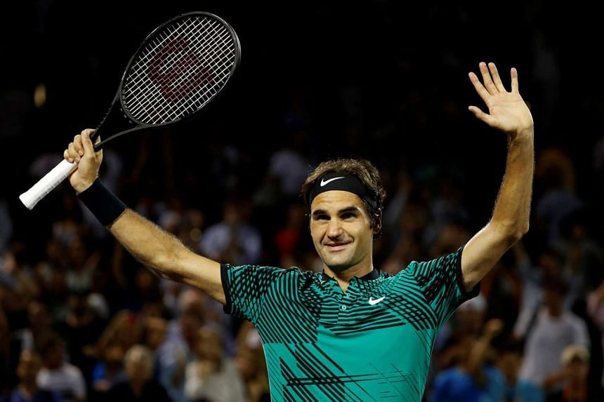 Roger Federer of Switzerland waves to the crowd after his match against Nick Kyrgios of Australia (not pictured) during a men's singles semi-final in the 2017 Miami Open at Brandon Park Tennis Center.