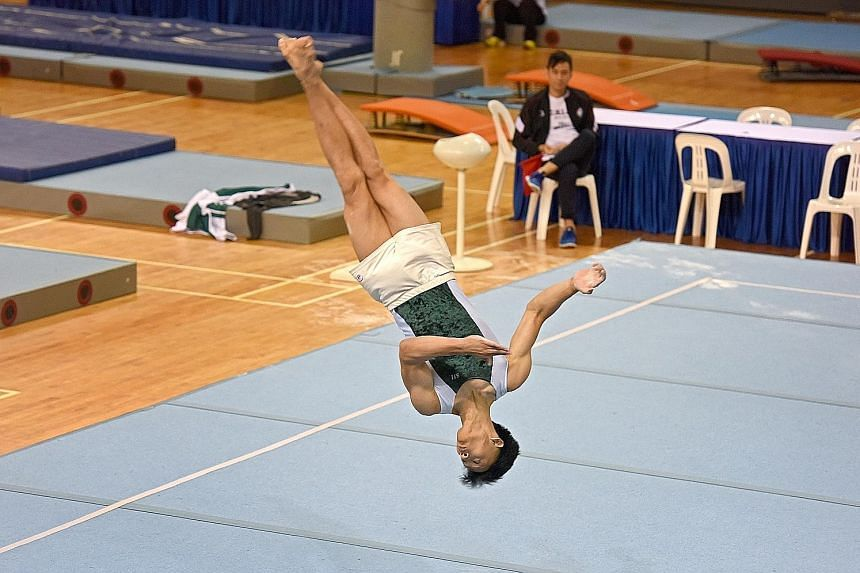 St Joseph's Institution's (SJI) Zac Liew (right), 16, clinched the individual all-around boys' title yesterday on the final day of the National School Games B Division artistic gymnastics championships. The Secondary 4 student scored 37.350 points fr
